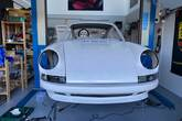 Front view of a Singer style front bumper on a 964 backdate project.